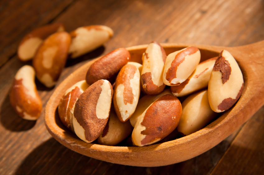 Brazil nuts in a hand made wooden spoon