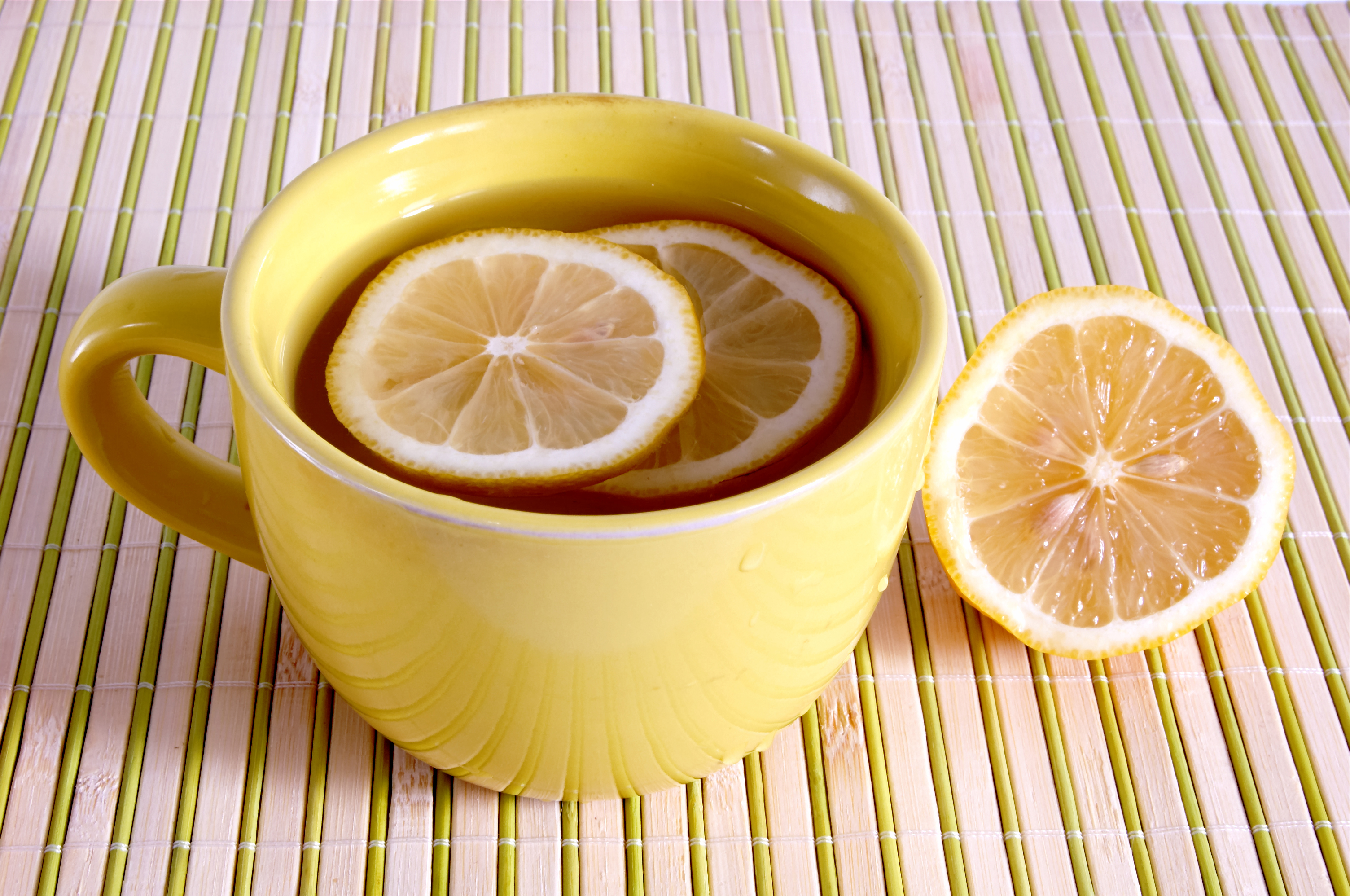A cup with tea and lemons