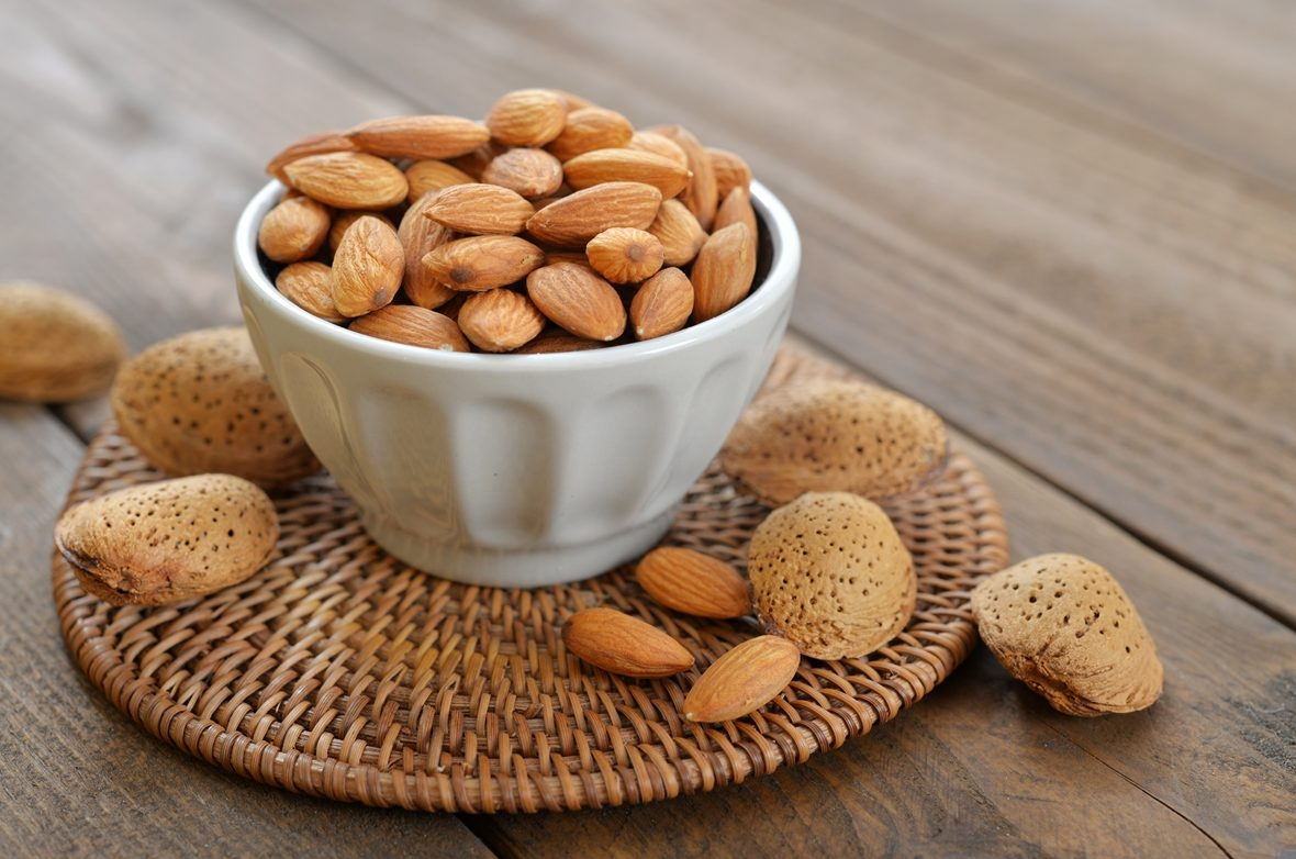 A-small-bowl-filled-with-fresh-Almonds.-Perfect-and-healthy-snack